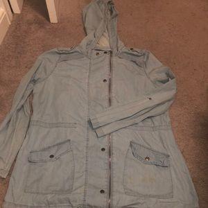 Light , light blue jacket .